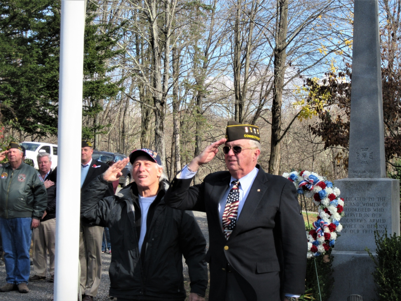 Jack Tyransky and Sandy Sanderson salute the American Flag after raising it.